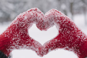Snowy hands heart